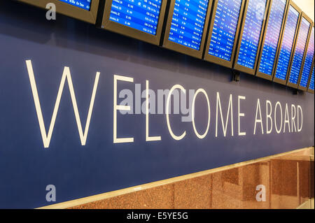 Delta Airlines flight information boards welcome air travelers to Atlanta International Airport, the world's busiest - Stock Photo