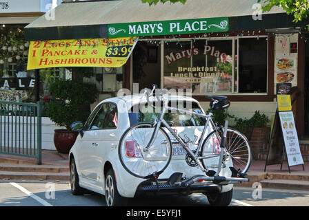 car with bike rack parked in front of Mary's Place cafe in Novato California - Stock Photo