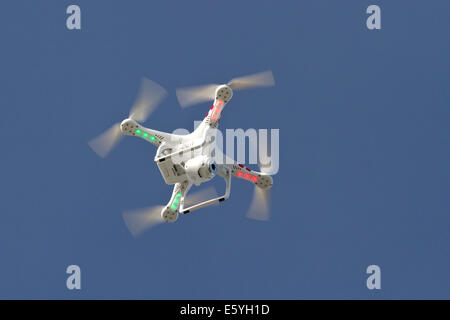 small unmanned helicopter with a camera floating in the blue sky Antarctica - Stock Photo