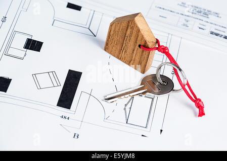 Closeup to key on house plan - Stock Photo