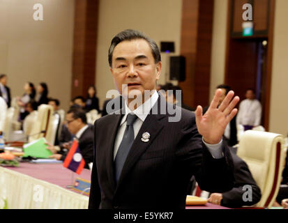 Nay Pyi Taw, Myanmar. 9th Aug, 2014. Chinese Foreign Minister Wang Yi waves to the media ahead of the China-ASEAN - Stock Photo