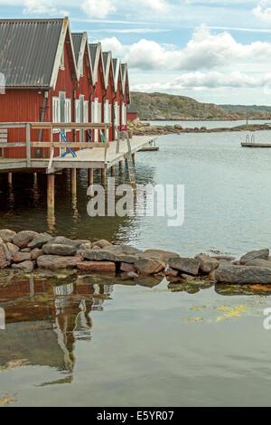 Red wooden cottages at Hällene, Tjörn, Bohuslan, Västra Götalands Iän, Sweden. - Stock Photo