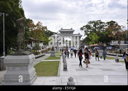 The Bodhi Path, with statues of the 12 Divine Generals, and pai lau in the distance. Tian Tan Buddha, Ngong Ping, - Stock Photo