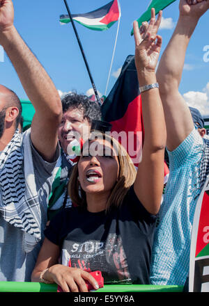 London, UK. 09 August, 2014.  A Pro-Palestinian female activists with painted lips in the colours of the Palestinian - Stock Photo