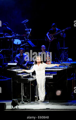 Toronto, Ontario, Canada. 9th Aug, 2014. Greek pianist, keyboardist, composer, and music producer YANNI performs - Stock Photo