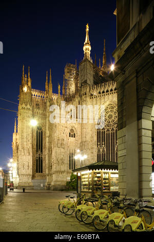 Bicycles for hire near the gothic Duomo or cathedral, Milan, Italy - Stock Photo