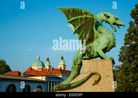 Slovenia, Ljubljana, Dragon Bridge and St Nicholas church - Stock Photo