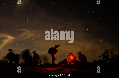 US Soldiers with the 82nd Airborne Division conduct mission planning during a night training exercise operated by - Stock Photo
