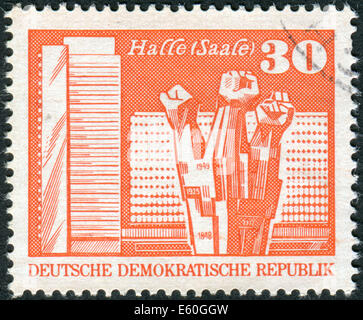 GERMANY (DDR) - CIRCA1973: Postage stamp printed in Germany, shows Workers Memorial, Halle (Saale), circa 1973 - Stock Photo