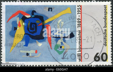 Postage stamp printed in Germany, dedicated to the 100th anniversary of Willie Baumeister, painting Bluxao I - Stock Photo
