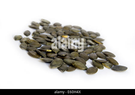 Green pumpkin seeds isolated on the white background - Stock Photo