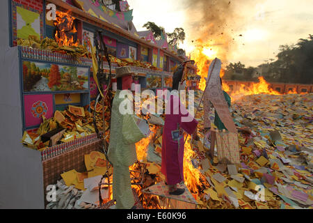Medan, Indonesia. 10th Aug, 2014. Incense paper is burnt to honor people's ancestors during the Hungry Ghost Festival - Stock Photo