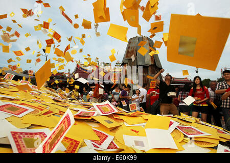 Medan, Indonesia. 10th Aug, 2014. Chinese Indonesians throw fake money to honor their ancestors during the Hungry - Stock Photo