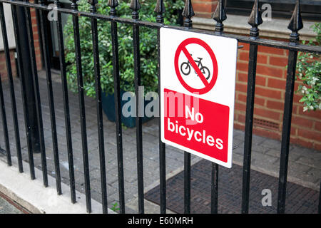 No bicycles sign in North London - preventing bicycles being chained to the railing - Stock Photo