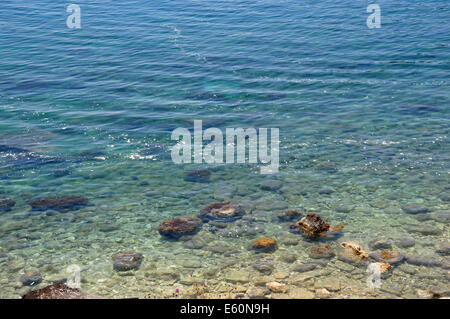 Dirt floating on sea surface. Polluted beach environmental issues. - Stock Photo