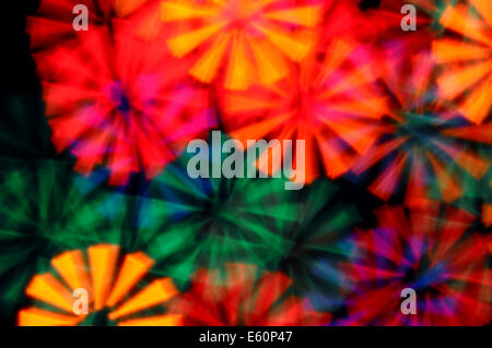 Colorful light rays abstract blurry circles psychedelic background.