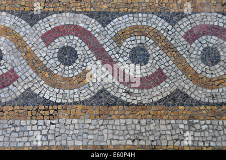 Floor mosaic background with circles pattern abstract geometric design on byzantine era church exterior. - Stock Photo
