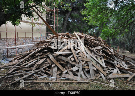 Big pile of old wooden planks at construction site. - Stock Photo