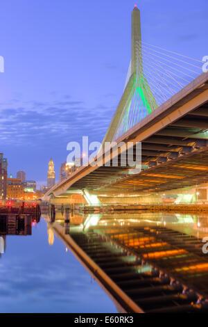 The Leonard P. Zakim Bunker Hill Memorial Bridge reflected on the Charles River at dawn in Boston, Massachusetts. - Stock Photo