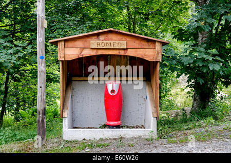 Cute wooden shelter for a water hydrant in the village of Le Lavancher nera Chamonix in the French Alps. - Stock Photo