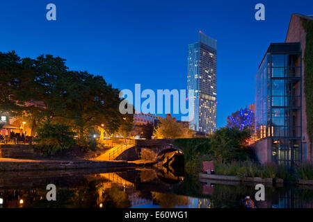 The Castlefield Urban Heritage Park and historic inner city canal conservation area with Beetham Tower in Manchester - Stock Photo