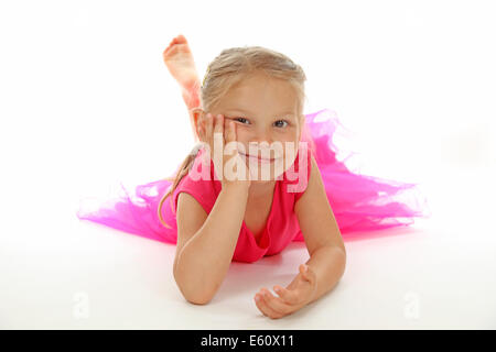 Cute girl in ballerina dress on white background - Stock Photo