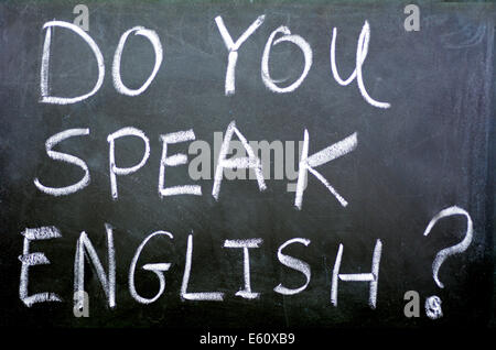 Do you speak English? Handwritten with white chalk on a blackboard.concept photo of learning and teaching English - Stock Photo