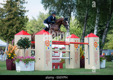 Bratislava, Slovakia. 10th Aug, 2014. Kleis Thomas (GER) on horse For Success jumps over hurdle during Mercedes - Stock Photo