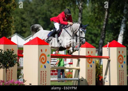 Bratislava, Slovakia. 10th Aug, 2014. Hruska Zdenek (CZE) on horse Calata jumps over hurdle during Mercedes-Benz - Stock Photo