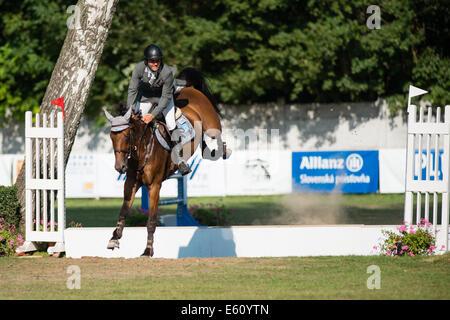 Bratislava, Slovakia. 10th Aug, 2014. Kazmierczak Michal (POL) on horse Stakorado jumps over hurdle during Mercedes - Stock Photo