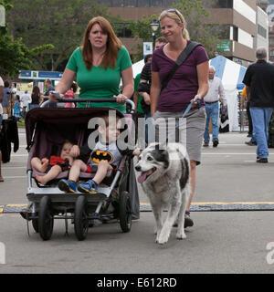 People enjoy Bastille Days in Milwaukee, Wisconsin, USA. - Stock Photo