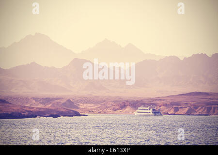 Vintage picture of a boat on the sea in Egypt. - Stock Photo
