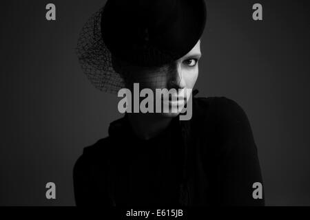 Woman wearing a hat, portrait - Stock Photo