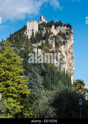 Mighty cliff with the ruins of Arco Castle or Castello di Arco above Arco, Sarca Valley, Trentino-Alto Adige, Italy - Stock Photo