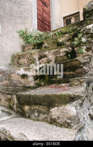 Old stone steps leading up to an habitation - Stock Photo