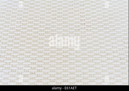 White cream plastic surface with repeating pattern. For use as background. - Stock Photo
