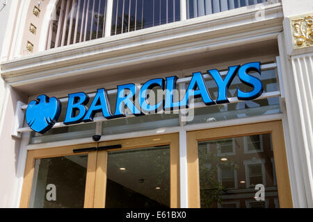 Barclays Bank sign and phoenix logo above the doorway of a high street branch. Manchester, England, UK, Great Britain - Stock Photo
