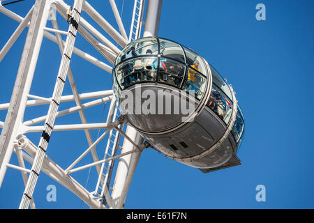 A capsule on the London Eye or Millenium Wheel on the South Bank of the River Thames in London England UK. JMH6347 - Stock Photo
