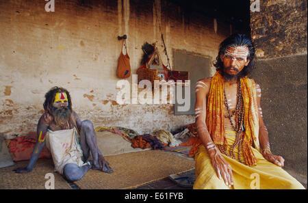 Hindu ascetics ('sadhu')  in their shelter ( Nepal) - Stock Photo