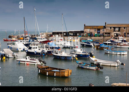 UK England, Dorset, Lyme Regis. boats moored within the Cobb Harbour - Stock Photo