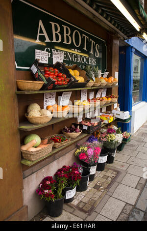UK England, Dorset, Shaftesbury, Bell Street, well stocked outside display shelves of greengrocer's shop - Stock Photo