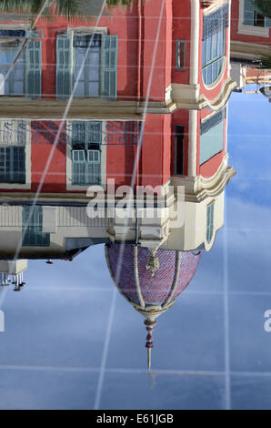 Reflections of Belle Epoch Architecture in Miroir d'Eau Fountain on Place Massena, Town square or Plaza Nice Alpes - Stock Photo