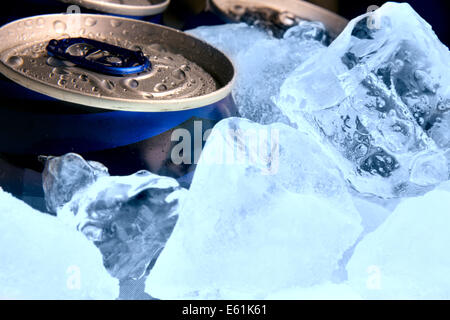 Aluminium cans of beer and ice - Stock Photo