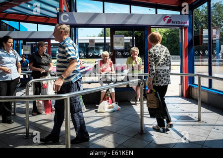 People waiting in Basildon Bus Station. - Stock Photo