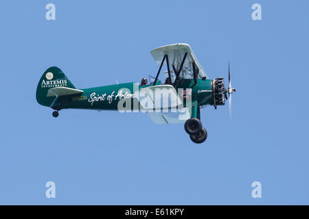 Spirit of Artemis Biplane with pilots flying over Cowes, Isle of Wight - Stock Photo