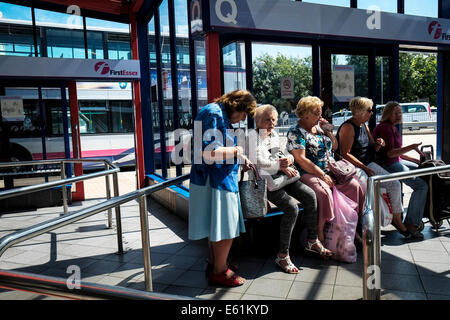People queueing in Basildon Bus Station. - Stock Photo