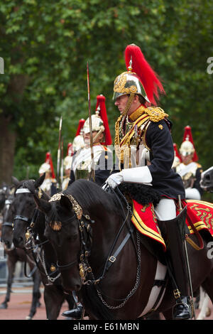 Members of the Blues and Royals, Household Cavalry, on The Mall in London during the Trooping the Colour parade - Stock Photo