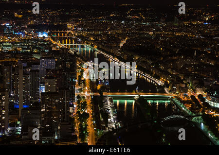 Aerial view of Paris at night from the top floor of the Eiffel Tower, Paris, France - Stock Photo