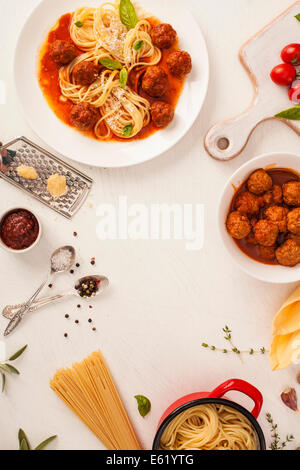 Spaghetti with meatballs with fresh basil and tomato sauce - Stock Photo