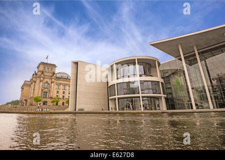 The Paul-Loebe-Haus, part of the government buildings, and the German parliament building (Reichstag) in Berlin - Stock Photo